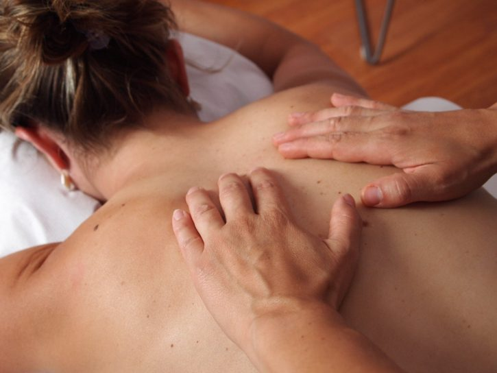 physiotherapy massage; a women's back being massaged