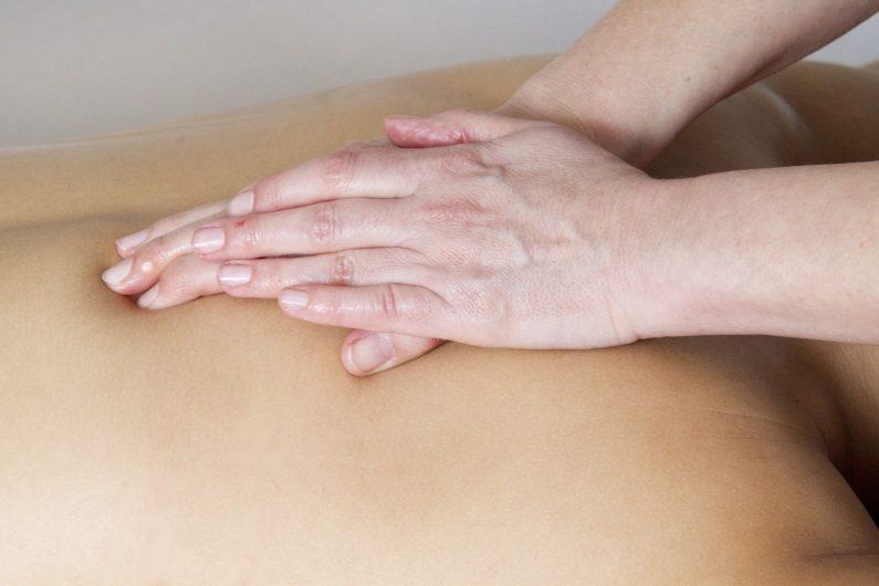 a back being massaged